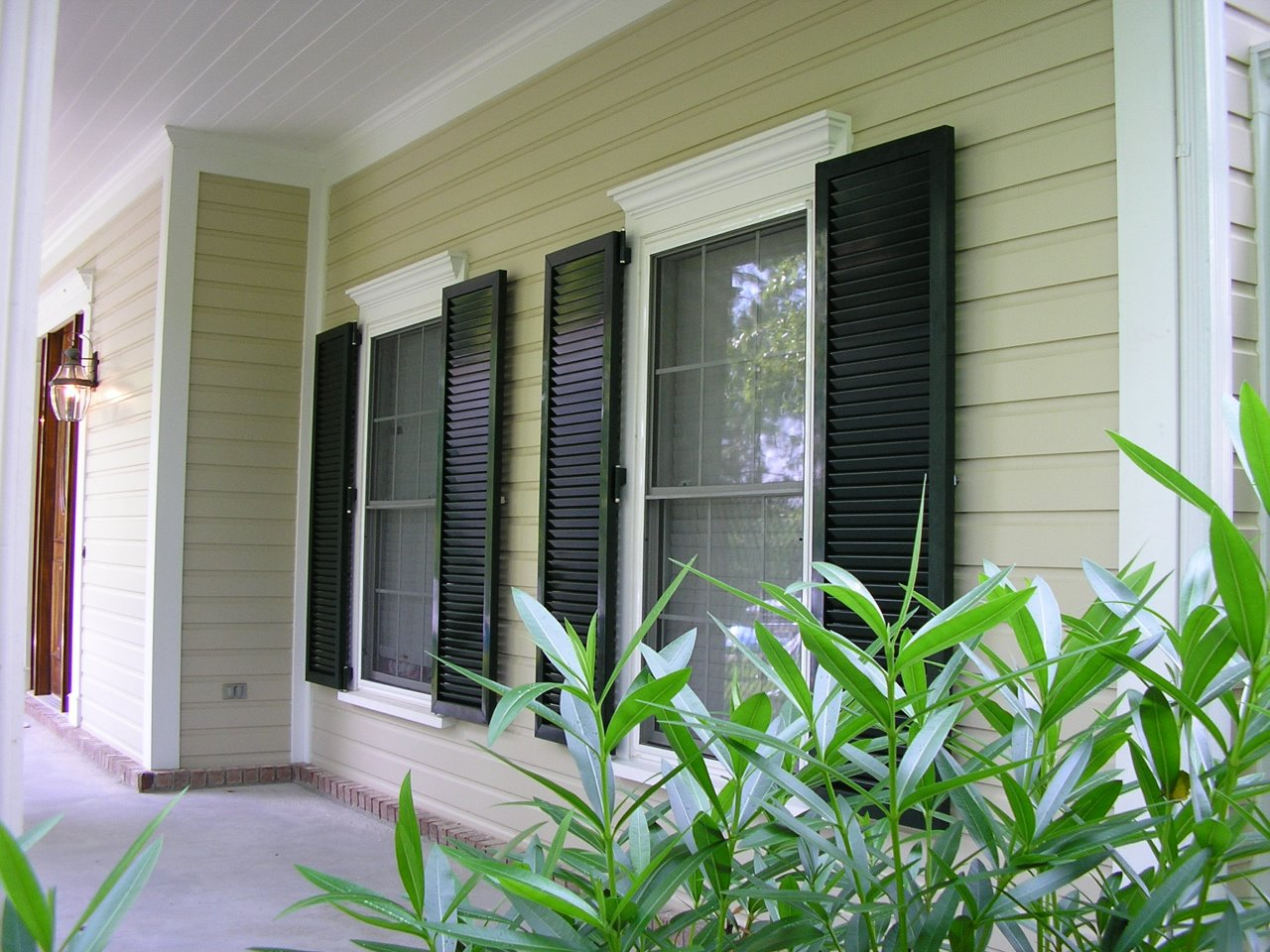 Hurricane shutters bahama shutters coastal north carolina for Colonial window designs