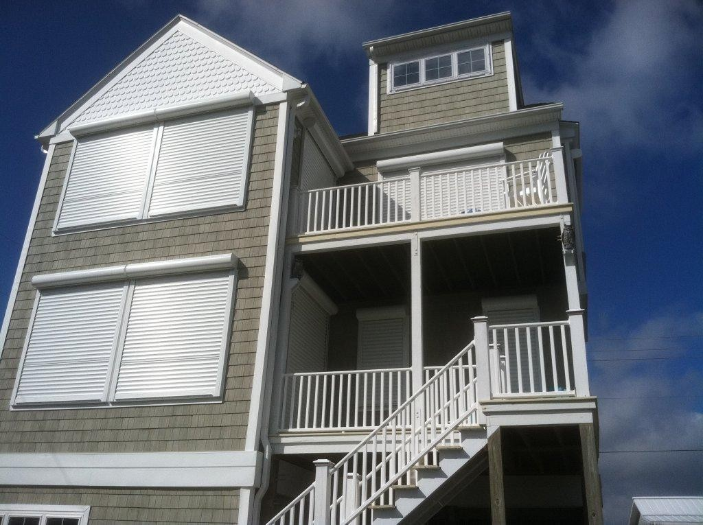 Rolling shutters atlantic breeze storm shutters awnings - The rolling shutter home in bohemia ...